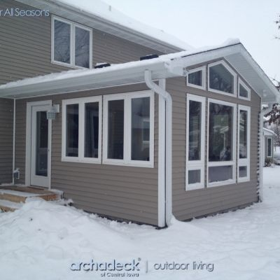 This 4-season room addition in West Des Moines replaced a deck space.  A combination of crank out, fixed and canopy windows by Jeld-Wen surround this cozy room.  Click here to see an interior view of this room. Rooms for all seasons by Archadeck of Central Iowa.