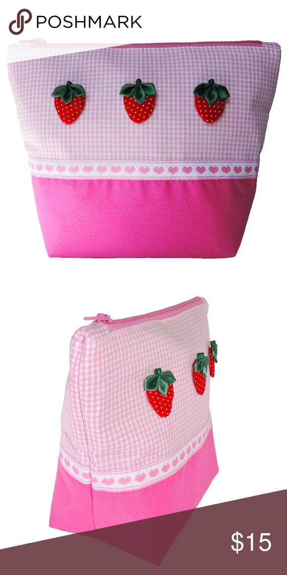 Strawberry Cosmetic Purse New With Tag. Strawberry Cosmetic Purse. A multi-purpose purse. Perfect for school, travel size toiletries or make-ups. Double interior lining. Accented with handmade strawberries. Color: Pink Gingham. Made in USA.  Cosmetic Purse Dimensions:  WIDTH: 8 Inches LENGTH: 6 Inches DEPTH: 3 Inches Starfruit Club Bags