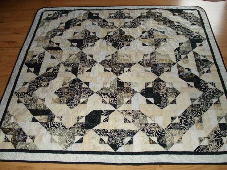 Handmade Quilt Batiks in Black,White and Cream, Blanket, Lap Quilt, Bedding by Jstitch on Etsy https://www.etsy.com/listing/156694221/handmade-quilt-batiks-in-blackwhite-and