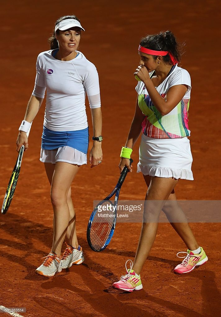 Martina Hingis of Switzerland and Sania Mirza of India look on, during their match against Irina-Camelia Begu and Monica Niculescu of Romania during day seven of The Internazionali BNL d'Italia 2016 on May 14, 2016 in Rome, Italy.