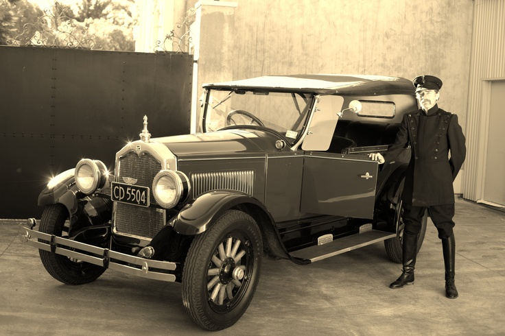 How about an English Chauffeur with original 1920's uniform? www.hooters-hire.co.nz