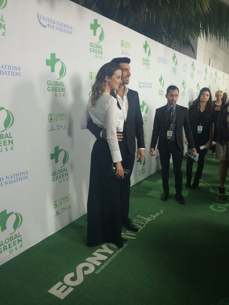 Actress Emily Foxler and actor Justin Baldoni walking on the green carpet, made by Aquafil's sustainable ECONYL® nylon and manufactured by Milliken, at the 13th Green Pre-Oscar® Party.