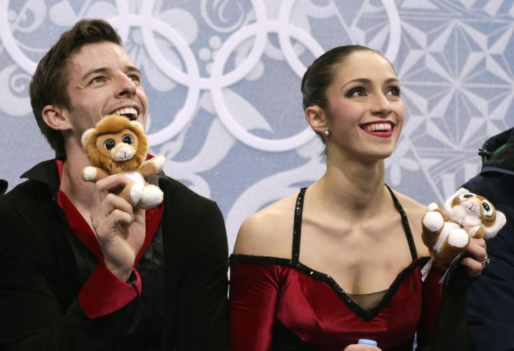 Stefania Berton and Ondrej Hotarek of Italy wait in the results area after competing in the pairs free skate figure skating competition at t...