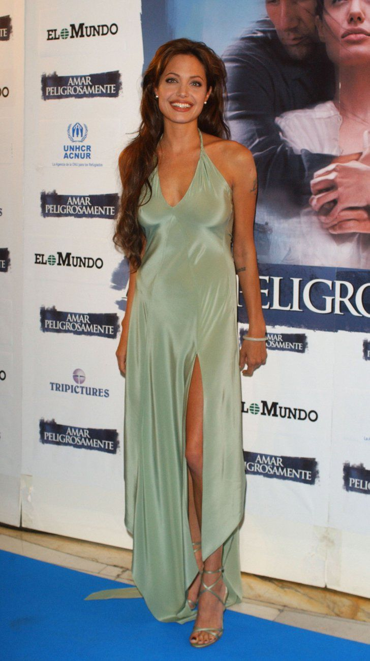 Pin for Later: How Vampy Did Angelina Jolie Go For Her Wedding? Angelina Jolie's Red Carpet Transformation In 2003, Angelina looked sexy in a seafoam silk camisole dress.