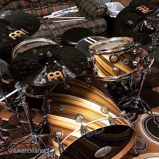Drum Workshop Drums and Meinl Cymbals. Beautify strips of wood in various shades of brown on the drum shells.
