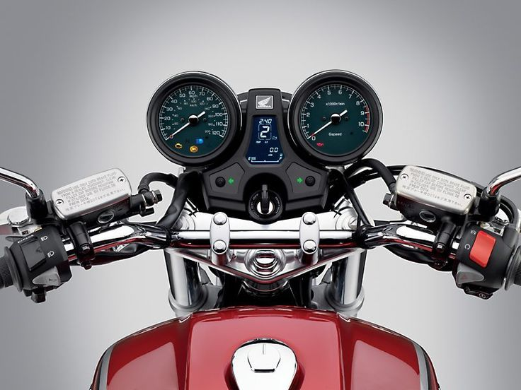 Honda nails the old-school look with the twin round gauges, chrome, Candy Red paint and sculpted fuel tank.