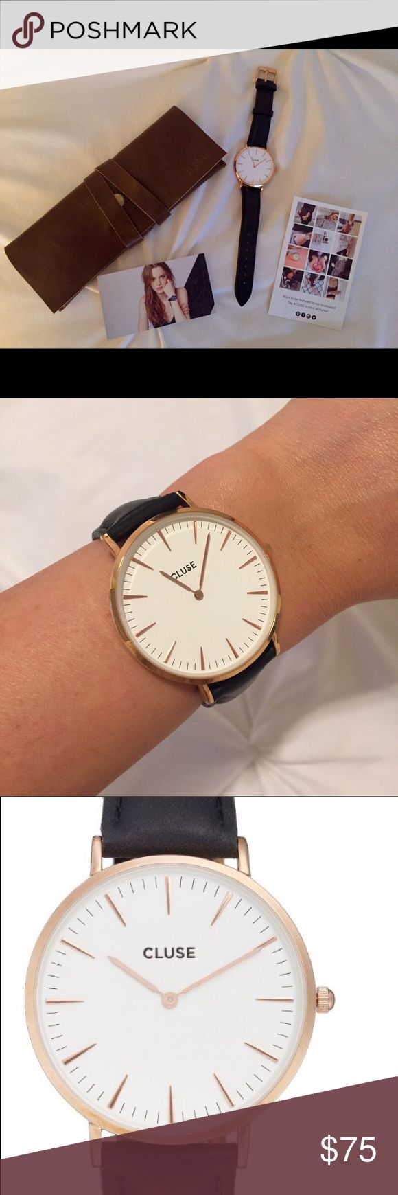 Cluse Watch Women's Cluse Watch. Black leather strap, gold and white face. Leather strap is in excellent condition and no marks on the face of the Watch. Comes with Cluse brown leather watch case. Cluse Accessories Watches