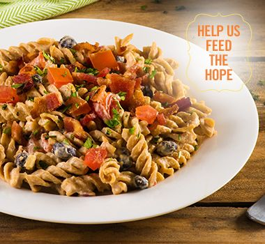 Rotini Pasta Salad with Spicy Black Bean Hummus | For every Facebook share or download of our Pasta to the Rescue cookbook or its recipes, we're donating portions of pasta to food banks across Canada. Visit https://www.catelli.ca/en/feed-the-hope/ to learn more.