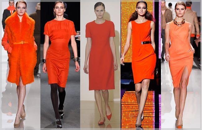 Оранжевое платье с черным поясом