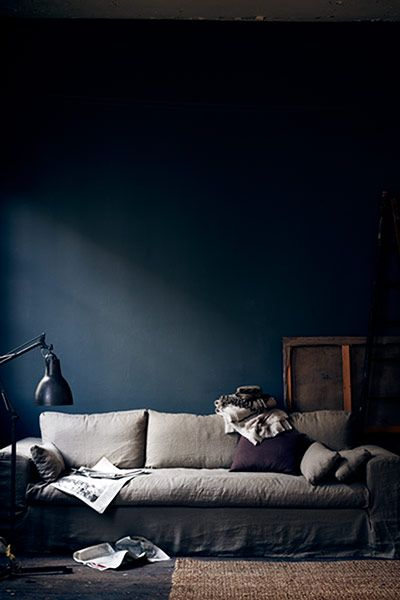 Credit: Pia Ulin The inspiration: a relaxed living room with petrol blue walls, a slubby linen sofa, and accessories in shades of grey and plum