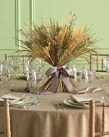 Table arrangements with natural elements perfect for an autumn wedding.