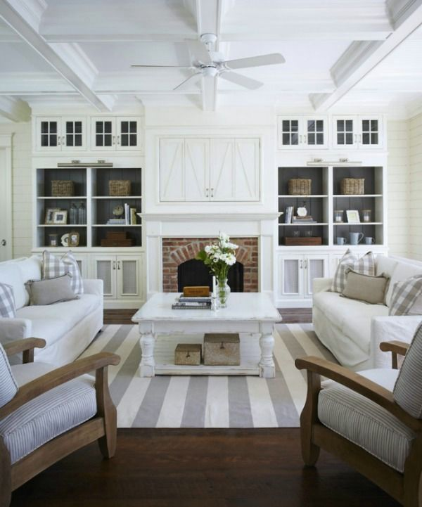 whites and greys with red brick fireplace.  the dark grey wall behind the built-ins gives it so much depth