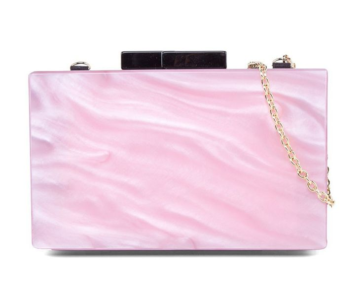 Marble Pearl Minaudiere by Something Borrowed.  Something borrowed come with a unique yet elegance piece,  this pink minaudiere with marble print, detachable handle drop 58,5 cm, and magnetic closure. http://www.zocko.com/z/JFjcB