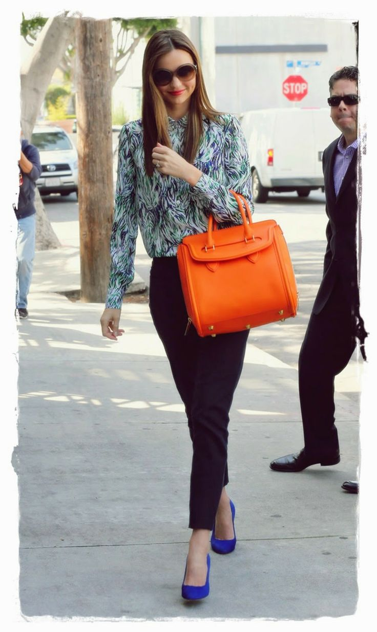 #Miranda #Kerr Handbags Style - Alexander McQueen Leather Tote Bag |  Miranda Kerr added some color to her look with this two top handled oversided tote. Miranda Kerr arrived at a meeting in West Hollywood wearing a blue-and-green printed Stella McCartney blouse with black cropped jeans, cobalt pumps, and a bright orange Alexander McQueen bag.