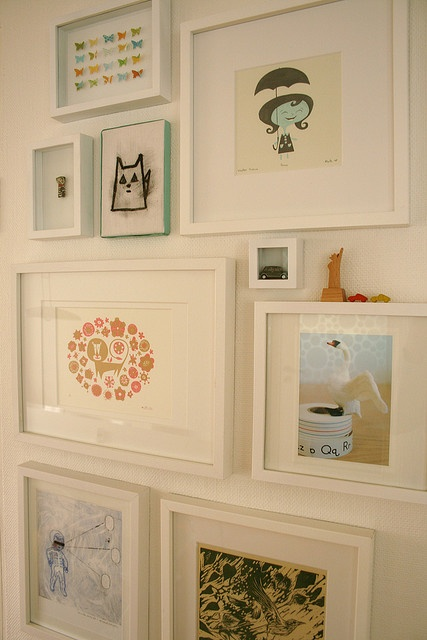 Art Wall. Love all the white frames and colorful prints.