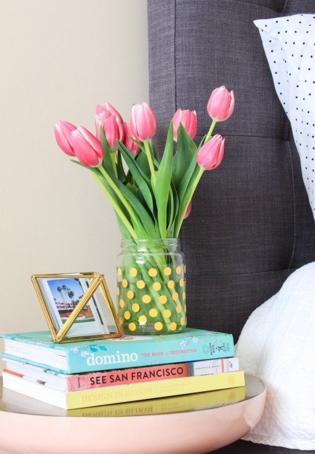 Wash out an empty glass pickle jar and cover it in a pattern of polka dot stickers to make a modern vase. | 5 Gorgeous 5-Minute DIY Projects To Try This Week