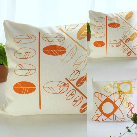 This modern cushion cover is handmade in a lovely thick weave natural color fabric. The design screen printed with water base inks represents twigs with leaves in bright orange hues. The envelope back side with snap buttons makes it easy to removal for washing.  An actual style design and the vibrant color will update any room bringing a breath of fresh spring air to your home.  Your pillow may vary slightly from the photo because I print the twigs randomly so there are no two covers exactly…