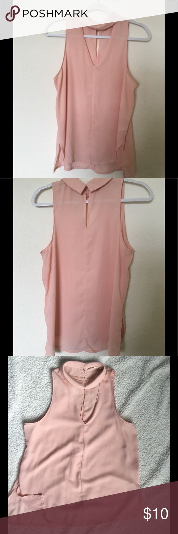 NWOT Eloide shirt Peach color new without tag Elodie. Side slit, flowy, sleeveless shirt. High neck with V neck opening. Elodie Tops Blouses