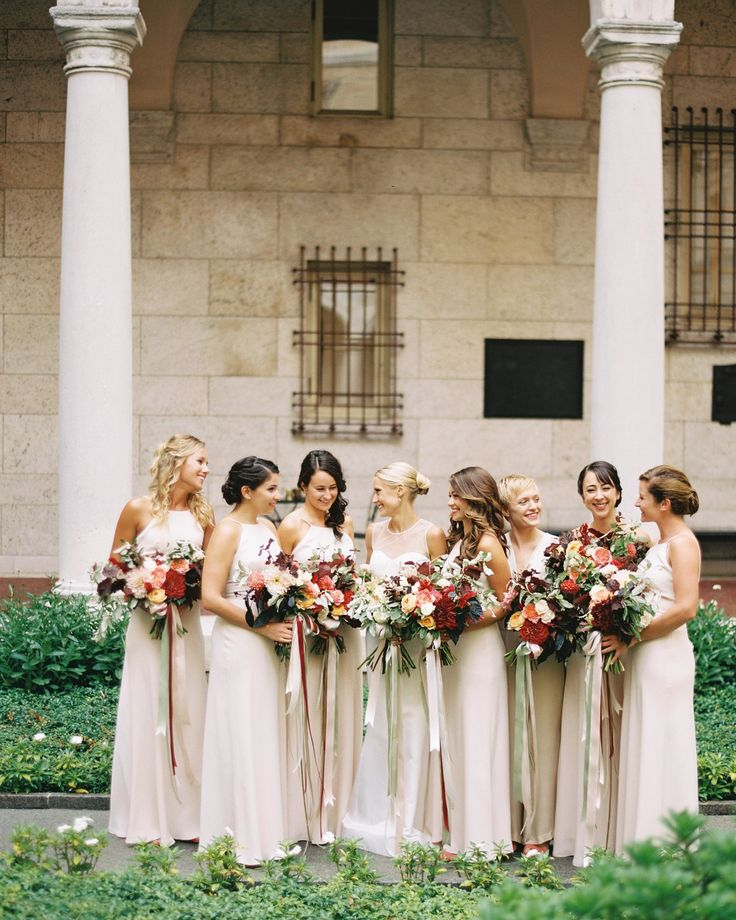 Katie also took the custom route for the maid of honor's jumpsuit, working with Kathryn Conover. The bridesmaids donned champagne chiffon J.Crew gowns.