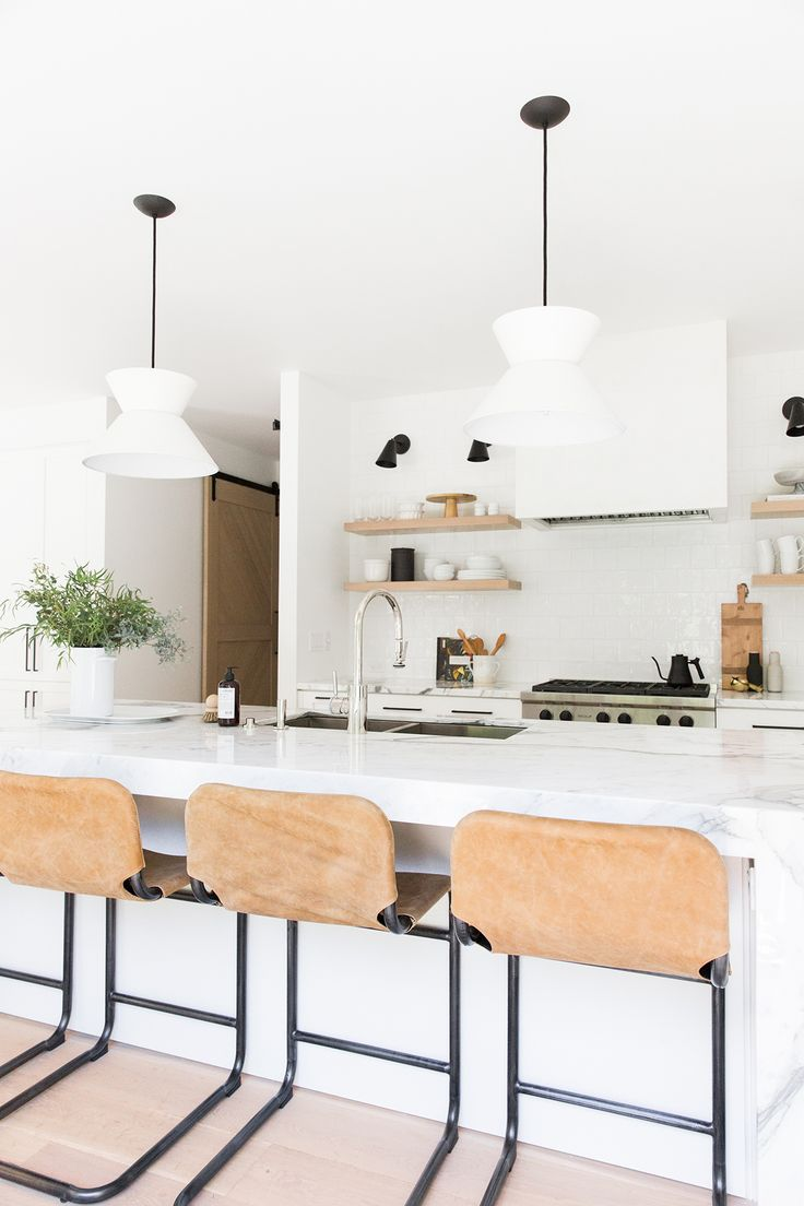 White Kitchen With Concrete Flooring And Open Shelving