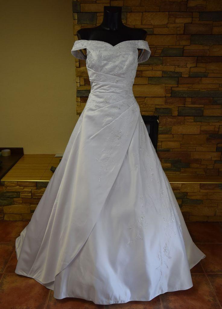 nové luxusní svatební šaty