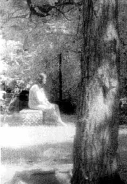 Madonna of Bachelor's Grove  ~  near Chicago is rumored to be one of the most haunted cemeteries in the world. Ghost Research Society member Mari Huff was there in 1991, taking high-speed, black-and-white photographs with an infrared camera. After they were developed, the image of what was a bare grave appeared to have a visitor.