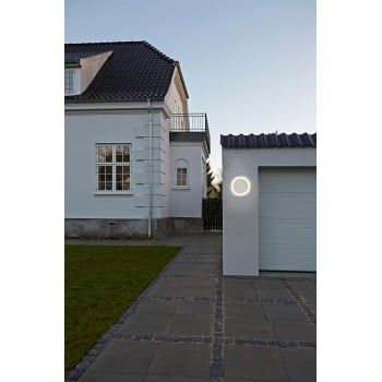 A modern round outdoor wall light in a white finish, the light is LED lit making it very low energy using only 7 watts but providing around 673 lumens or the equivalent of just over 65 standard watts. This fitting is also IP44 rated making it safe for exterior use, it can also be used without need of an earth wire as it is double insulated. It also makes an ideal light for a modern bathroom.