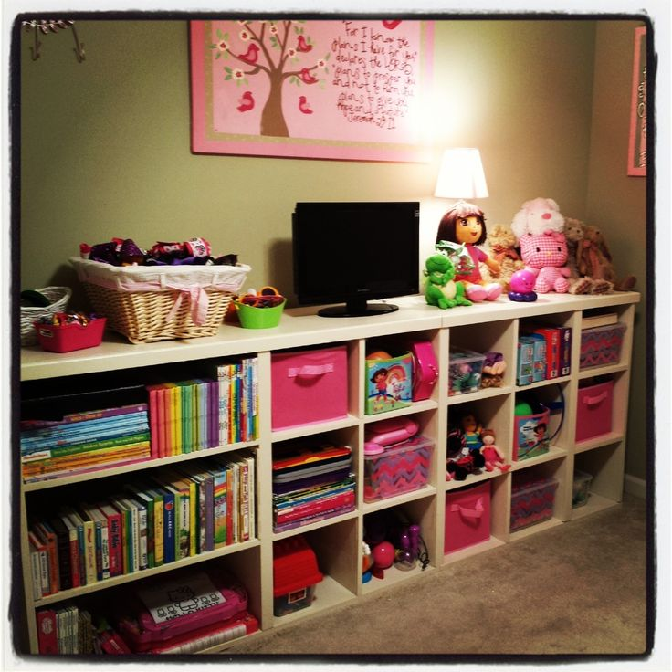 My husband built this shelving unit for our 4-year old's bedroom. I absolutely love it!! It was not the cheapest toy storage solution, but worth every penny.