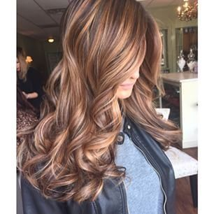 Dark brown hair with caramel highlights. by Patricia Mariani