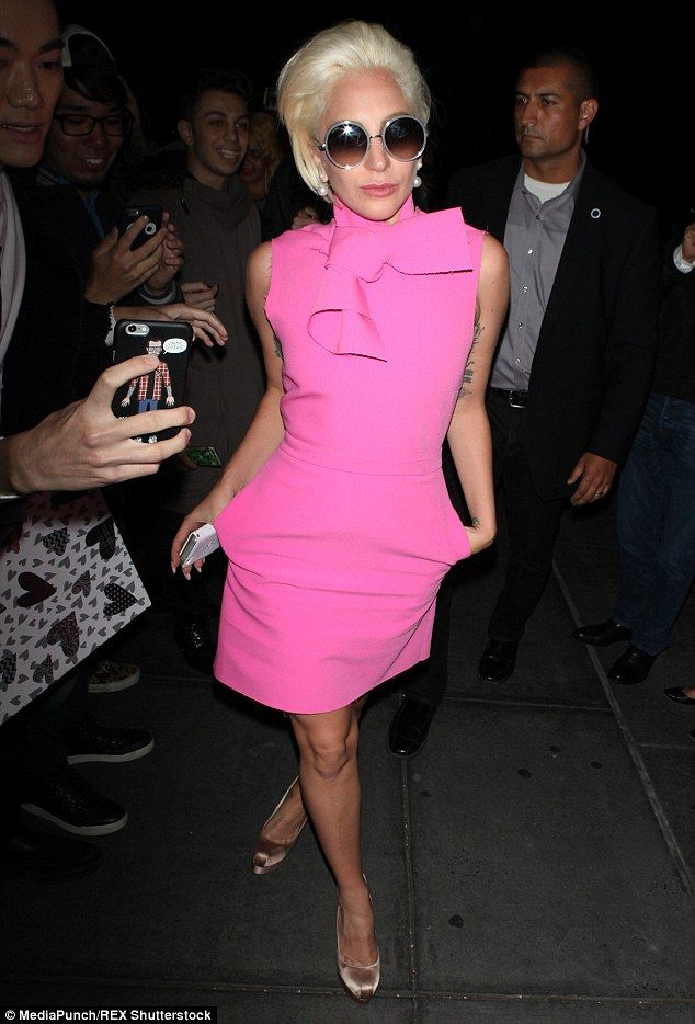 Make way: Turning heads as she passed by, the 29-year-old star looked absolutely in bright pink dress and chic satin heels