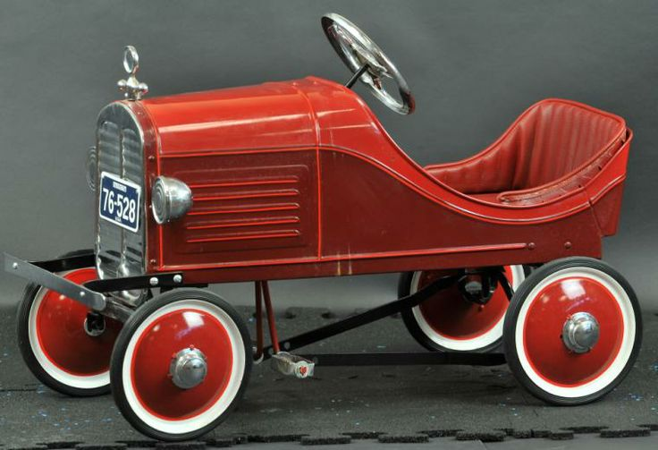 "STEELCRAFT LITTLE JIM OAKLAND PEDAL CAR c. 1930's, pressed steel, smaller child sized pedal car, painted in red body, disc wheels, rubber tires, an inexpensive auto for its day and early edition, light play wear. 35"" l. Professionally restored with re-manufactured parts."