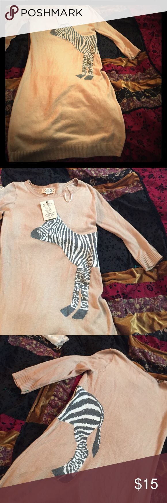 Sweater dress zebra animal print body con Adorable knit sweater dress with zebra on front and back absolutely adorable I wear a four regular and this is a little bit too snug for my taste. Would be perfect for a true petite or someone who was a two or zero. Dresses Long Sleeve