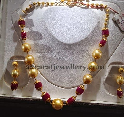 Jewellery Designs: Ruby Drops Gold Color Pearls Set