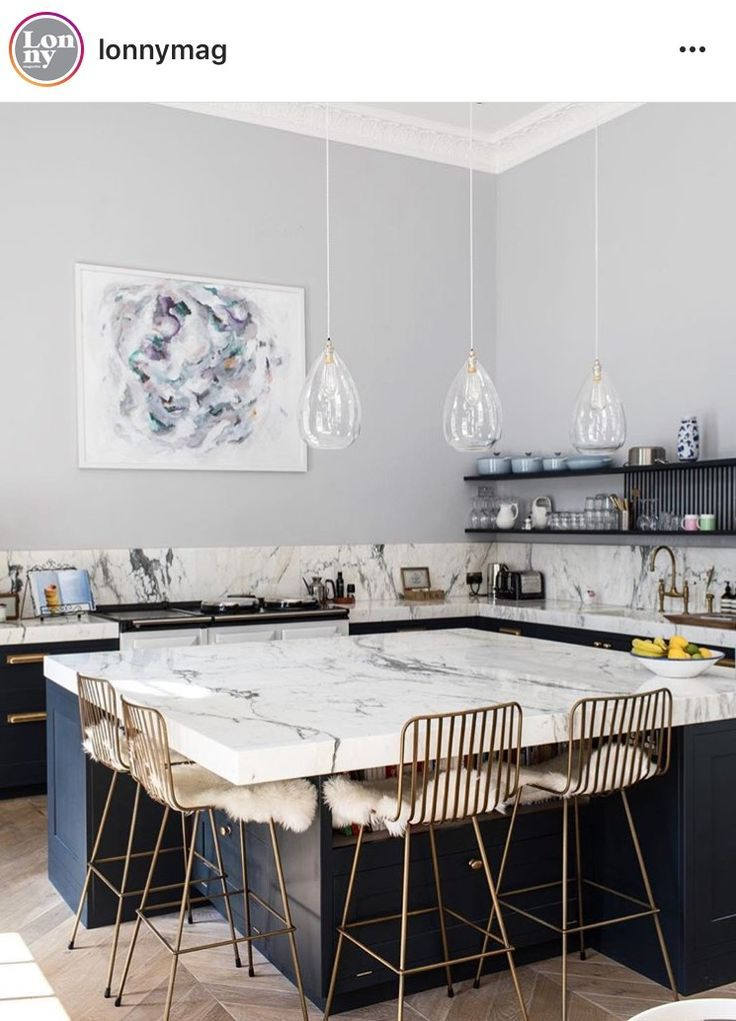 Kitchen designed by laura butler madden thick marble worktop in big space