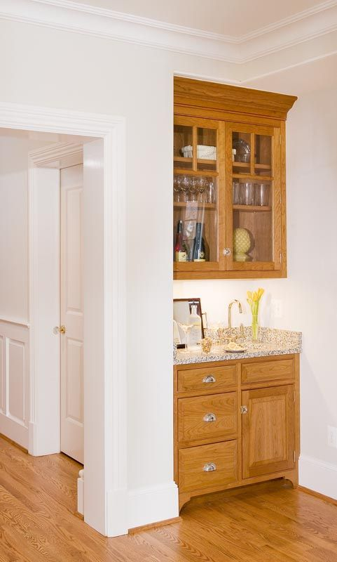 tiny bar nook with cabinet feet