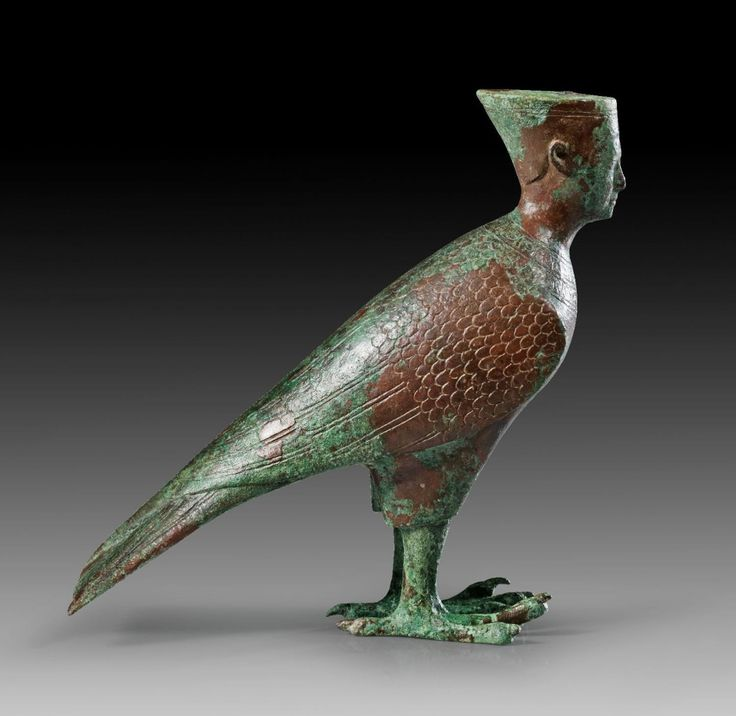 Egyptian Bronze Ba-Bird Figurine, Roman Imperial Period, 2nd Century ADThe falcon body has the human head of a pharaoh. He wears the double-crown of which only the red crown of Lower Egypt is preserved, the upper part is missing. He also wears a...