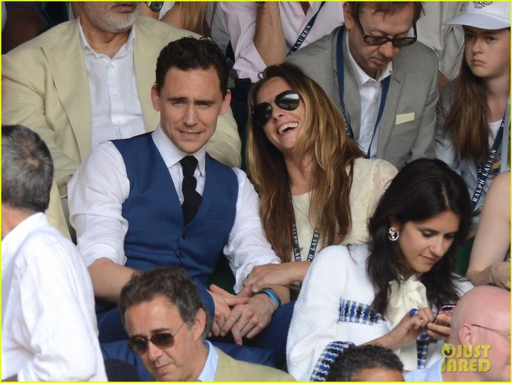 Tom Hiddleston and his new rumored girlfriend Jane Arthy hold hands while watching the Men's Singles Final during the Wimbledon Lawn Tennis Championships at the All England Lawn Tennis and Croquet Club on Sunday (July 7, 2013) in London, England./// DON'T WORRY GIRLS. He is squinting at us and realizing what he is missing.