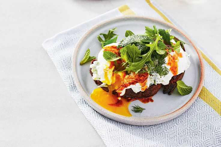 """Çilbir (pronounced """"chilber"""") is a traditional Turkish dish made with poached eggs and yogurt. Here, we've transformed it into elegant dinner tartines."""