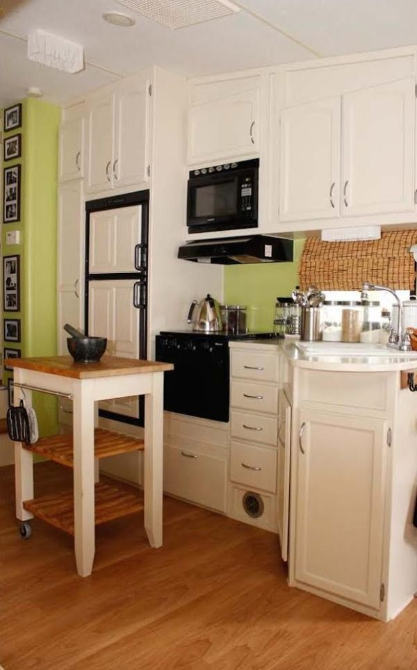 Couple Renovate 5th Wheel Travel Trailer into Tiny Home Photo.  The full kitchen picture.  I would replace the green paint with apricot paint.  So pretty!