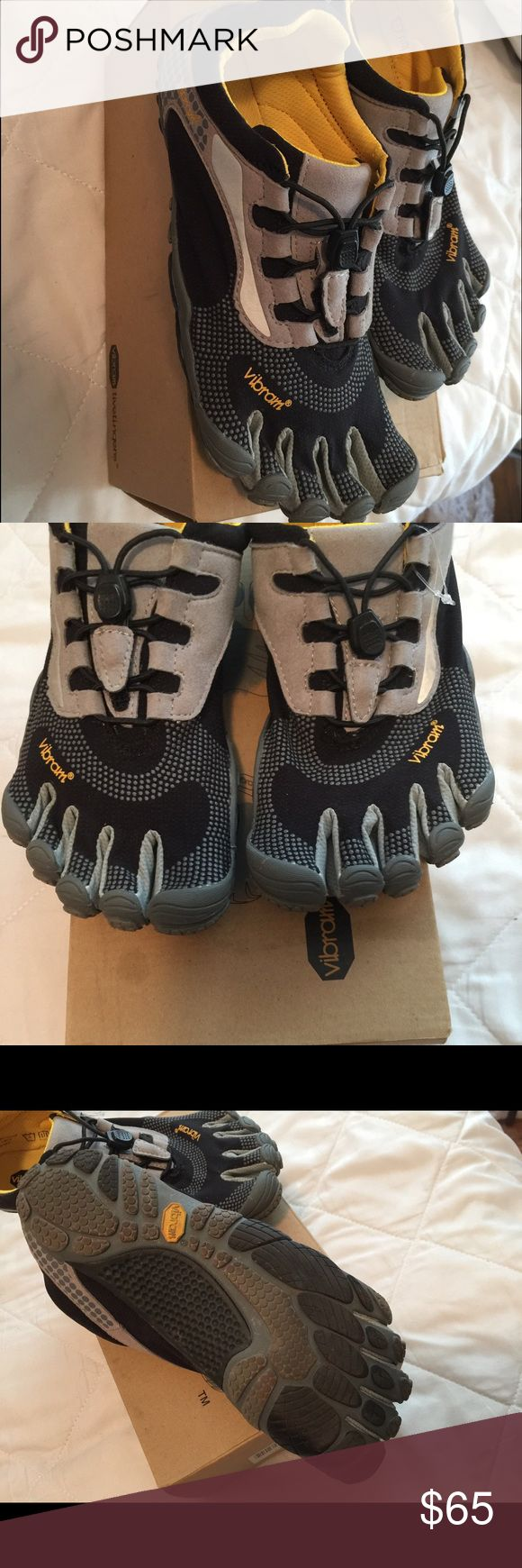 Vibram FiveFingers toe shoes worn a handful of times . comfortable (for those who aren't cared to be different ) great condition . good for biking , running and exercising // box says size 38 -- women's 7 Vibram Shoes