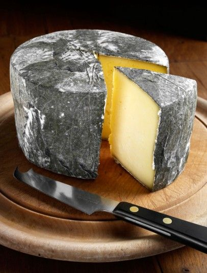 Cornish Yarg cheese, wrapped in nettles. Based near Truro. They also do one covered in wild garlic, as well as a heart-shaped truckle.    www.lynherdairies.co.uk
