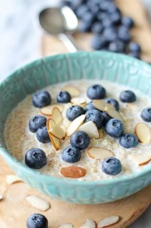Quinoa Bircher muesli with blueberries & passionfruit Preparation time 10 mins + overnight standing Ingredients 11/2 cups milk 1 tsp vanilla bean paste 11/2 cups traditional rolled oats 1/2 cup quinoa flakes 2 punnets Eureka blueberries 2 passionfruit, halved yoghurt & honey to serve