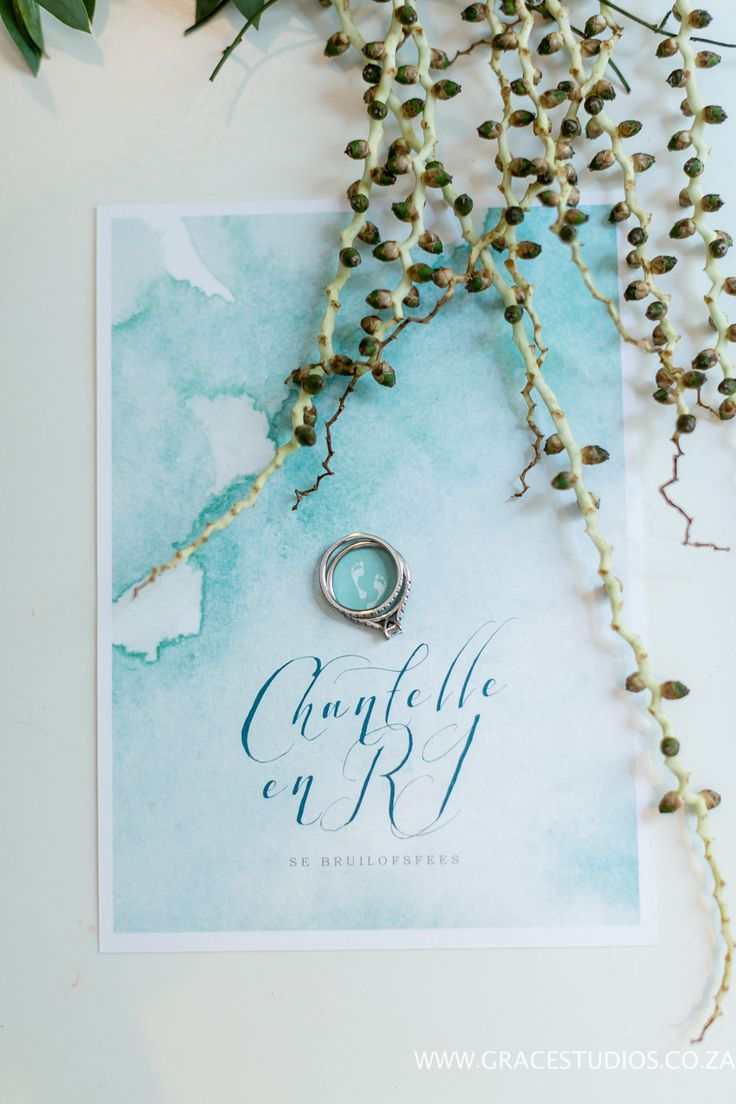 watercolour beach inspired wedding invitation: teal blue inspiration, beach wedding decor, luxury south african beach wedding, palm berries   http://www.absoluteperfection.co.za/#!CHANTELLE-AND-RJS-ROMANTIC-INTIMATE-BEACH-WEDDING/c1jar/57ad8b610cf2d58e4d0423e6
