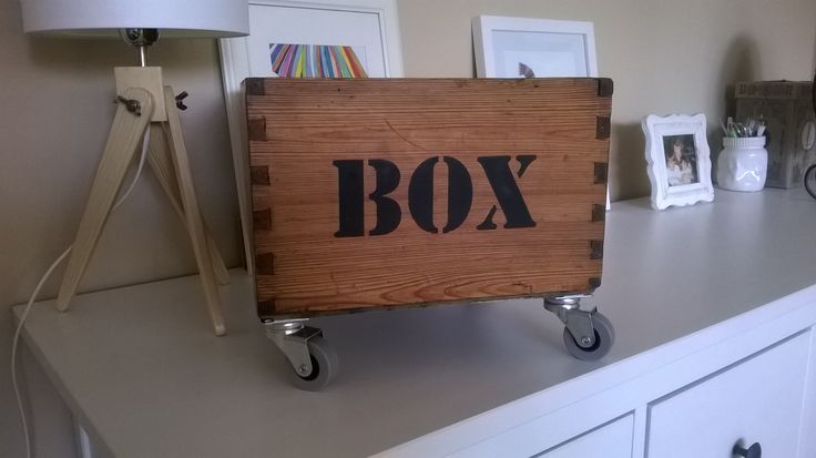 Old wooden box on wheels-recycled