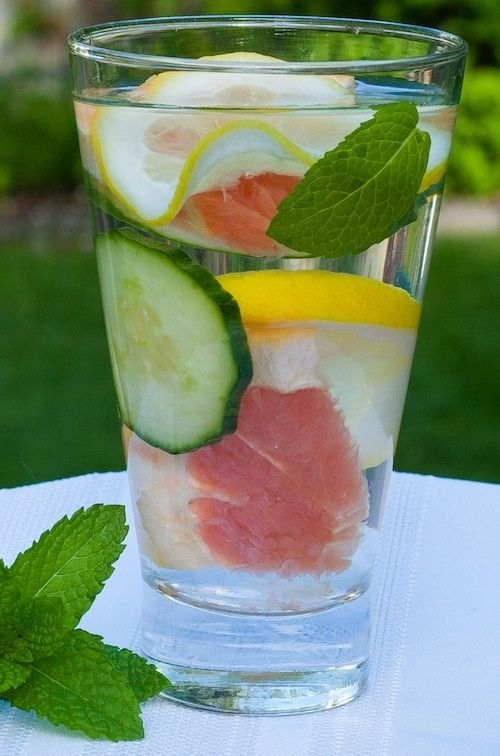 Dieters Dream Detox Water: cold filtered water, grapefruit sections, lemon slices, cucumber slices, and mint leaves.