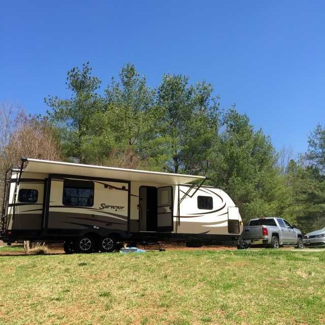 2015 Used Forest River Surveyor Travel Trailer in North Carolina NC.Recreational Vehicle, rv, 2015 Forest River Surveyor 32 RLTS. Island kitchen with oven and 4 burner stove top, electric fireplace that puts out amazing heat, pull out sleeper sofa and theater seating with bluetooth surround sound indoor/outdoor speakers and LCD tv. Huge bedroom; I had a pillow top queen mattress in it with room to walk around! Tons of storage in bedroom and in the 3 outside compartments. LED lights in…