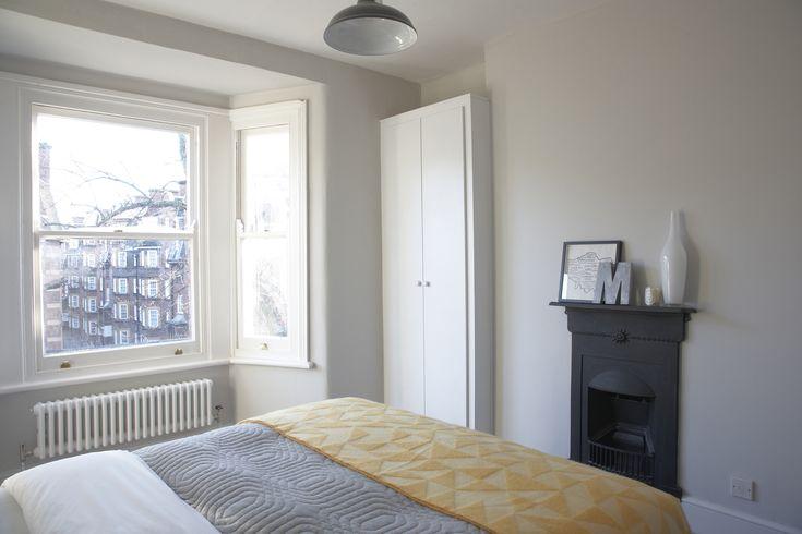 cornforth white bedroom - black fireplace