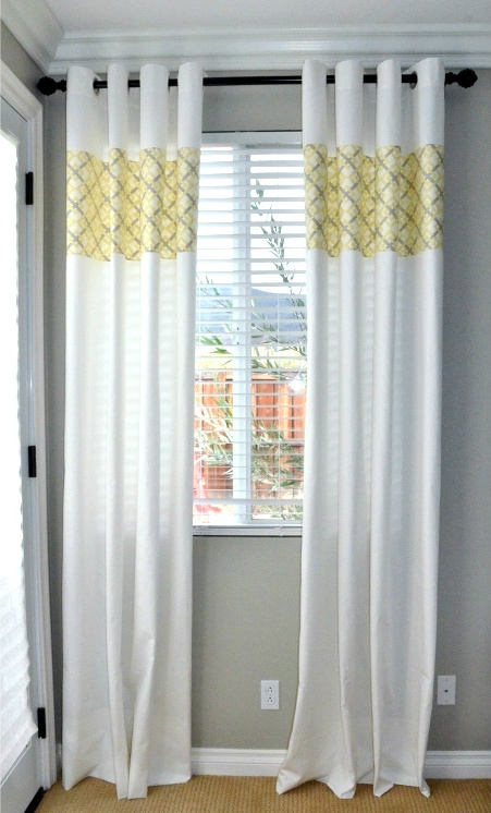 Add a pop of color to solid curtains by cutting the curtains and inserting a favorite fabric.
