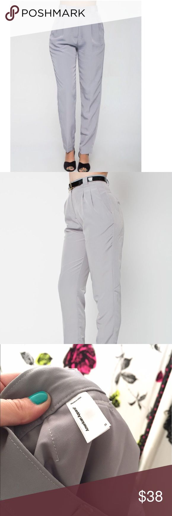 American apparel poly silk trouser American apparel poly silk trouser pants with pleats. Is a size small . Waist is measured at 13.5 inch. Across so it should fit 26-27 waist. Super cut but it's loose on me . The inseam is 29inch. Perfect condition . No signs of wear. Color is a light grey and the light it reflects a silver grey shine . American Apparel Pants Trousers