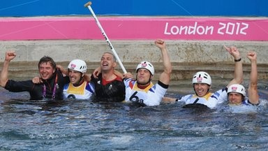 Gold and Silver medal-winning canoeists Etienne Stott (second left), Tim Baillie (right), David Florence (second right) and Richard Hounslow (third right) with coaches